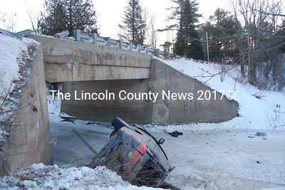 The driver of this 2004 Honda mini-van escaped with non-life threatening injuries after rolling over into the Trout Brook in Alna Tuesday morning. (J Maguire photo)