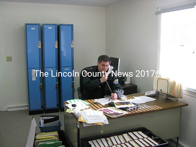 Wiscasset Police Administrator Lt. John Allen, seated comfortably at the superintendent's office off the Gardiner Road in Wiscasset, hasn't missed a call. Some books are still in boxes and after only about a week in the new location, staff are still getting adjusted. (J Maguire photo)
