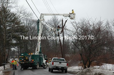 Crews from Central Maine Power replace a utility pole on Nobleboro's Borland Hill. The pole and transformer were damaged during Monday evening's high winds. (Joe Gelarden photo)