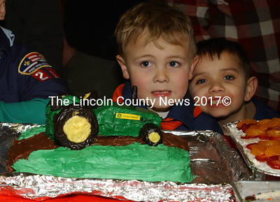 Nathan Crossley stands behind his tractor cake and Jonathan Burke behind his pineapple upside down cake. (Paula Roberts photo)