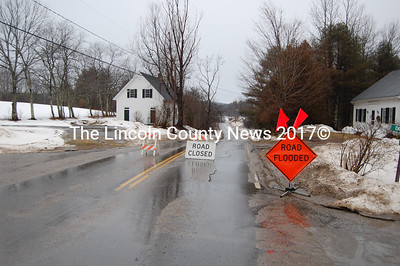 Flooding on Headtide Rd (Rt. 194) in Alna Tuesday prompted workers to close the road. Commuters drove around the flooded area by taking the Dock Road by the Alna Store. (J Maguire photo)