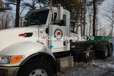 Lincoln County Recycling has a couple new trucks to haul the large cans local transfer stations use to collect paper, cardboard and other recyclables. (J Maguire photo)
