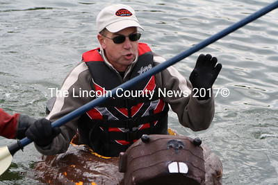"David Geiger and his pumpkin-beaver race to the dock during  the first ""heat"" of the  regatta competition on Oct. 10. (Matthew Stilphen photo)"