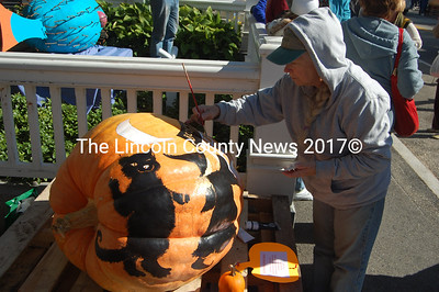 Judith Mitchell, book and pumpkin illustrator, at work. (J.W. Oliver photo)