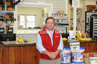 Hancock Lumber of Damariscotta Project Pro Randall Waltz awaits the public at the customer service desk. (Matthew Stilphen photo)