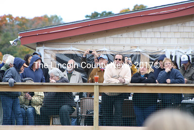 "Spectators enjoy a few ""eye openers"" on the Schooner Landing deck and catch a glimpse of the regatta action. (Matthew Stilphen photo)"