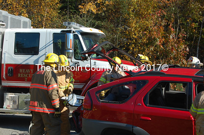 Bristol and South Bristol firefighters attempt to gain access through the vehicle's rear hatch. (J.W. Oliver photo)