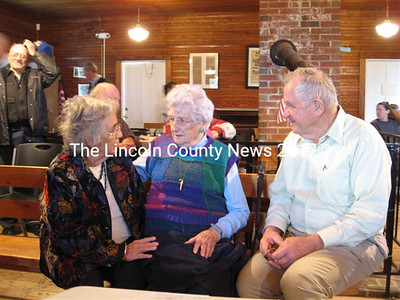 Arolyn Antognoni, Lydia Chase and Albert Boynton (left to right) were among those who shared accounts of the North Whitefield fire of 1948 at the townhouse on Sunday. (Lucy Martin photo)