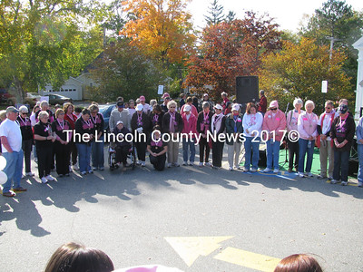 The crowd joined breast cancer survivors for a moment of silence for those loved ones who have passed on. (John Maguire photo)