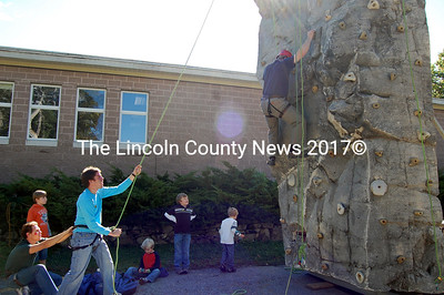 Dad shows the kids how it's done on the Kieve climbling wall outside NCS at Applefest. (Alex Toy photo)