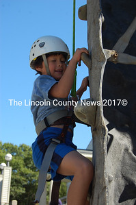 "Marcus Russano, ""6-and-a-half-and-three-quarters"" of Jefferson, scales Camp Kieve's rock climbing wall at Applefest Oct. 2. (Alex Toy photo)"