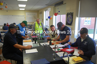 From left to right, Deputy EMA Director Ken Desmond, Newcastle firefighter and chaplain Jim O'Brien, Damariscotta firefighter Steve O'Bryan, [] and Damariscotta firefighters Josh Pinkham and Josh Martin at work in a Lincoln Academy laboratory. (J.W. Oliver photo)