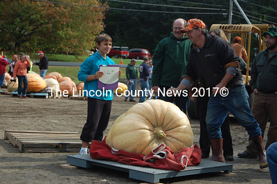 Riley Golding, 10, of Damariscotta, poses with her 346 lb. pumpkin, the runner-up in the youth volunteers division. (J.W. Oliver photo)