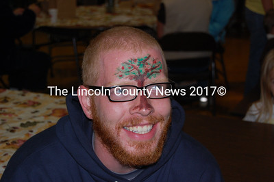 Will Randolph, a volunteer with the Kieve Leadership School, gets into the Applefest spirit with some unique face paint. (Alex Toy photo)