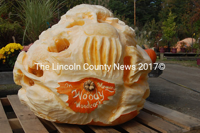 "Andy Rice, a self-described ""wildlife wood carver and sculptor"" dedicated thiscarving to Woody Woodcock, a Waldoboro man, longtime coworker and the grower of this pumpkin. Woodcock passed away Sept. 30. (J.W. Oliver photo)"