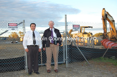 JVS Principal Peter Gallace, left, and AOS 93 Superintendent Robert Bouchard stand in front of the construction site for the new JVS school. (Samuel J. Baldwin photo)