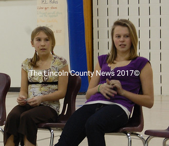 "Michaela Sprague, left, and Hunter Herron await their words in the final rounds of the Lincoln County Spelling Bee on Feb. 8. at the Jefferson Village School. Herron emerged with the county title by correctly spelling ""omniscient."" (Alex Toy photo)"