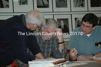Bristol Selectmen huddle over 2010 budget. From left they are Robert Tibbets, Paul Yates and Chairman Chad Hanna. (Joe Gelarden photo)