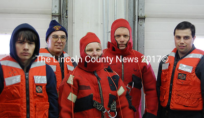 The Somerville Cold-Water Rescue Team poses before heading outside for live rescue training. From left: Kyle Veilluex, Fiire Chief Mike Dostie, Martha Staples, David Stanley and Tim Dostie. (Alex Toy photo)