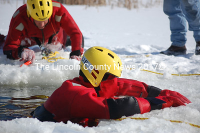 Somerville Assistant Fire Chief David Stanley prepares to enter the water and rescue Jason Chapman during a cold-water training in Washington (Alex Toy photo)