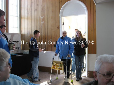 Whitefield resident Louise Russell Dancer, grandmother of Pastor Les Dancer, enters the sanctuary Feb. 7 to hear her grandson's first message in what was the Russell family's traditional house of worship, now reorganized as Sheepscot Valley Community Church.