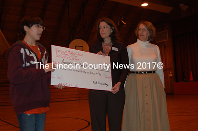 Wiscasset Middle School eighth grader Nick Brackley presented a check to the Mid Coast Chapter of the American Red Cross in the amount of $1536.72 during a school assembly on Tues., Feb. 9. He had intended to raise just $300 and was surprised by the tremendous support in the effort. Accepting the check were Connie Jones, Executive Director of the Mid Coast Chapter of the American Red Cross (center) and Dee Miskill, a member on the Mid Coast Chapter Board of Directors. (J Maguire photo)