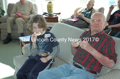 Nine year old Dylan Squires and his new friend, Gene Duston, 85, share Valentine's Day cookies at the Lincoln Home. (Joe Gelarden photo)