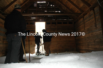 Volunteers inside the Thompson Ice House Museum await another block of pond ice. (Joe Gelarden photo)