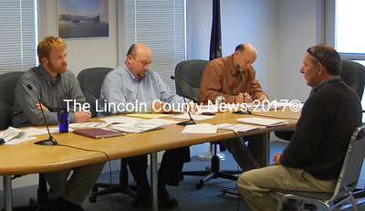 Members of the Economic Development Committee of Waldoboro (From left: Patrick Wright, Town Manager William Post, and Dana Dow) meet with Downtown Restoration Taskforce spokesman Joe Carey. (Samuel J. Baldwin photo)