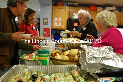 Ellie Taylor (far right) and Sandra Rumery serve spaghetti and meatballs to guests at a dinner hosted by the Lincoln County Democrats. Chellie Pingree was the guest of Honor. (Alex Toy photo)