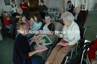 Debbie Christie serves Valentine cookies to Anna Hatch, 10, and Loretta Briggs at the Lincoln Home. (Joe Gelarden phtoto)