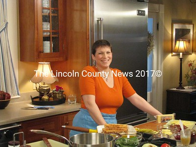 "Newcastle author Cynthia Simonds pauses during the taping of her new PBS television cooking show ""Fresh to Flavorful"" in a Westport Island kitchen last week. The show debuts on Maine public television Feb. 13 at noon. (J Maguire photo)"