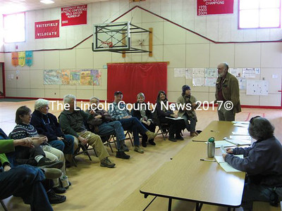 Jim Torbert (standing), elected chair of the Whitefield Democratic caucus on Sunday, addresses the 17 residents who turned out for the meeting. (Lucy L. Martin photo)