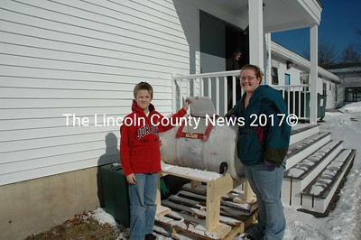Bristol Elementary School Pupils Jimmy Gagnon, 12, and Ashley Pooler, 13, show off the bin where school waste food products will become compost for the school's new garden project in the spring. (Joe Gelarden photo)