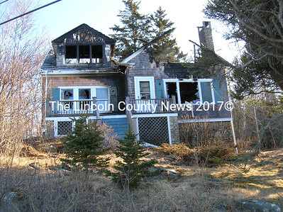 Tuesday evenings fire at Ocean Point in East Boothbay left this home in ruins. The resident, Foster Stroup, was not home at the time. Boothbay fire Chief Dick Spofford said the cause of the blaze is under investigtion by the state fire; marshal.r(Joe Gelarden photo)