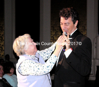 An unidentified member of the audience dances with Dean Martin (as played by Andy DiMino) during the Rat Pack Tribute performance at the Lincoln Theater March 5. (Greg Latimer photo)