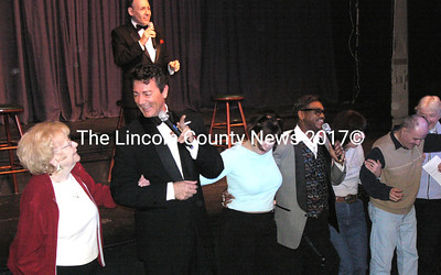 """The Rat Pack Tribute performers join audience members at the Lincoln Theater for some kick step dancing to """"New York, New York."""" (Greg Latimer photo)"""