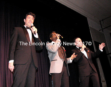 """The Rat Pack Tribute performers meet on stage for a renditon of """"My Way"""" during the March 5 CEF benefit show at the Lincoln Theater. (Greg Latimer photo)"""