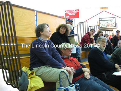 """Sue McKeen (sitting behind Cathey and Louis Sell) spoke in defense of the proposed central fire and rescue station, saying the town """"doesn't own anything"""" where citizens can assemble, """"not even our own school."""" (Lucy L. Martin photo)"""
