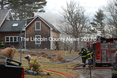 Firefighters and emergency personnel wasted no time in response to a fire at the home of Judith Sandick and David Nutt in Edgecomb. (J. Maguire photo)