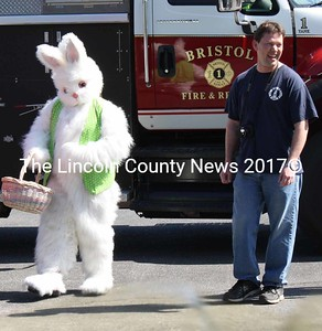 Bristol firefighter Neal Kimball with his friend, the Easter Bunny. (K. Lizotte photo)