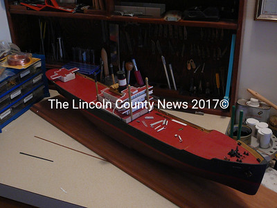 "Chester Hopkins of Damariscotta is working on this model of the WWII freighter ship ""Exton."" (J Maguire photo)"