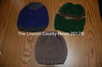 "Here are some of the hand knitted caps crafted by the Lincoln County ""hat ladies"" that were sent to Maine National Guard troopers in Afghanistan."
