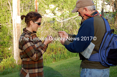 Master Guide Sean McCormick helps Brenda Weis from Whitefield choose a fly before she hits the water during the last week of the fly fishing adult education class through the Whitefield School. (Samuel J. Baldwin photo)