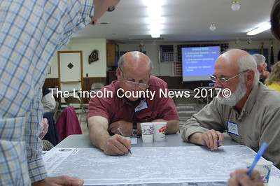 Waldoboro resident George Seaver, center, points out an area to focus on during the small group workshops at the first Waldoboro visioning session on May 18. Looking on are Dave Cole, right, and Ken Vencile, stading. (Samuel J. Baldwin photo)