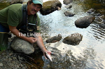 Randy Orff from Waldoboro shows off a brook trout he caught during the final week of the fly fishing adult education class through the Whitefield School. (Samuel J. Baldwin photo)