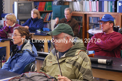 Roger Baston from Whitefield, foreground, and his fellow classmates in the fly fishing adult education class at the Whitefield School look on attentively as Master Guide Sean McCormick teaches them the tricks of the trade. (Samuel J. Baldwin)