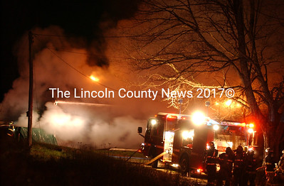 Fire fighters battle a structure fire on Bunker Hill Road in Jefferson Sun., April 18, at the former Peggy Lermond home. (Paula Roberts photo)