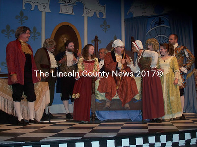 """Toinette (Ruth Monsell, center/right) gives a verbal trouncing to Argan (Don Carrigan, seated) in LCCT's """"The Imaginary Invalid"""" now in production. Cast members are (l-r) Rory Craib, Art Mayers, Tristan Crocker, Isabelle Lobley, Kit Hayden, Carrigan, Monsell, Phyllis McQuaide, Heidi Kopishke, and Jason Kash. (Kim Fletcher photo)"""