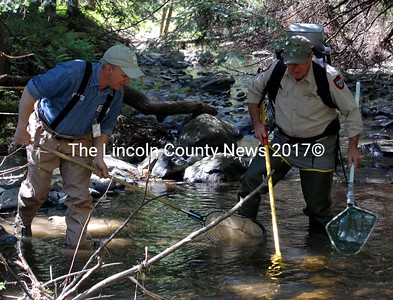 Trout Unlimited Volunteer Sean McCormick, left, and Regional Fisheries Biologist Bobby Van Riper electrofish to gather samples for the fourth-graders at Whitefield Elementary School. (Alex Toy photo)